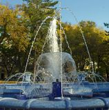 Fountain made of blue marble with water splashing around royalty free stock images