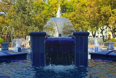 Fountain made of blue marble with water splashing around stock photography