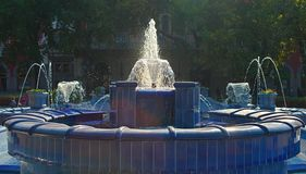 Fountain made of blue marble with water splashing around royalty free stock photography