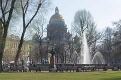 The fountain at the main entrance to the Admiralty building in St. Petersburg. People walk around stock photography