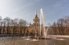 The fountain at the main entrance to the Admiralty building in St. Petersburg. People walk around stock image