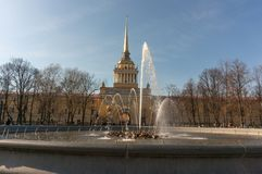 The fountain at the main entrance to the Admiralty building in St. Petersburg. People walk around royalty free stock photography
