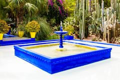 Fountain in Majorelle Garden in Marrakesh, Morocco. Blue square fountain in the Majorelle Garden in the City Center of Marrakesh, Morocco stock photography