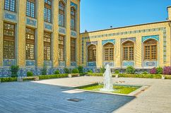 The fountain at Malek Museum, Bagh-e Melli quarter, Tehran, Iran. The small fountain in front of historical building of Malek museum and library, Bagh-e Melli stock images