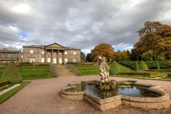 Fountain and a Mansion House. Royalty Free Stock Photo