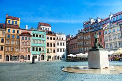 Fountain on marketplace square. Fountain and colorful old houses on old town marketplace square in Warsaw, the capital of Poland stock photos