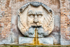Fountain with mask, Rome, Italy Royalty Free Stock Photography