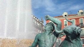 Fountain at Massena place, Nice. Detail of one green man and bull sculpture and of water at Fountain at Massena, Nice, south of France stock video footage