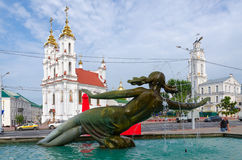 Fountain Merger of three rivers, town hall and church, Vitebsk. VITEBSK, BELARUS - JULY 13, 2016: Fragment of fountain Merger of three rivers on background of Stock Photo