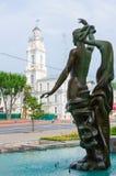Fountain Merger of three rivers and town hall, Vitebsk, Belarus. VITEBSK, BELARUS - JULY 13, 2016: Fragment of fountain Merger of three rivers on background of Stock Image