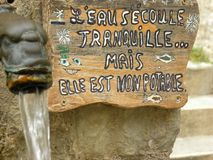 Fountain with message in Saint-guilhem-le-desert, a village in herault, languedoc, france. Fountain with message in Saint-guilhem-le-desert, a village in herault stock images