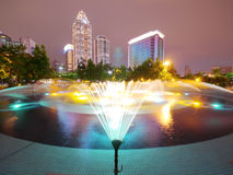 Fountain and modern buildings Stock Photography