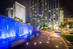 Fountain and modern buildings at night, seen at Romare Bearden P. Ark, in Uptown Charlotte, North Carolina Stock Photo