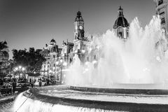 Fountain on Modernism Plaza of the City Hall of Valencia, Town hall Square, Spain. Modernisme Plaza of the City Hall of Valencia Placa del Ajuntament. Black stock photo
