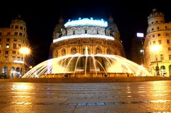 Fountain,spray,jets. Monumental fountain in square with period buildings Royalty Free Stock Image