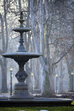 Fountain in the morning. Fountain in the park Zrinjevac, Zagreb, early morning with subtle blue hues and historic lanterns Stock Photo