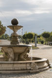 The fountain in the morning sun in the street Royalty Free Stock Photo