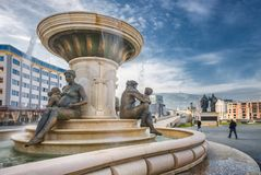 Fountain of the Mothers of Macedonia. Early morning view of the Fountain of the Mothers of Macedonia placed on the other side of the river Vardar from the main stock images