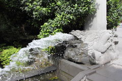 Fountain from the mouth of a stone dragon Royalty Free Stock Photography