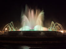 Fountain with movement water in Montjuic Stock Images