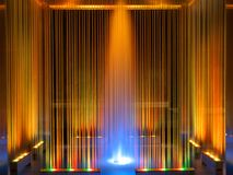Fountain, multicolored illuminated flowing water by night Stock Images