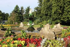 Fountain, Museum Gardens, Beacon Park, Lichfield. View of a fountain in the middle of a flower bed in Museum Gardens, Beacon Park, Lichfield, Staffordshire Stock Photo