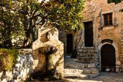 Fountain on the narrow alleys in Eze village in France stock photos