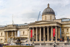 Fountain and the National Gallery on Trafalgar Square Royalty Free Stock Image