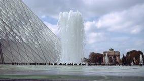 Fountain near Louvre glass pyramid stock footage