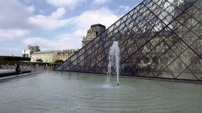 Fountain near Louvre glass pyramid stock video