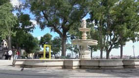 Fountain near Palacio Fox. Typical scene for visitors to Lisbon Portugal stock footage