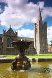 Fountain near St.Patrick's Cathedral. In Dublin, Ireland, blue sky and clouds Royalty Free Stock Image