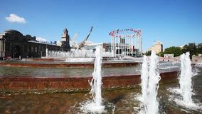 Fountain near the train Kievskiy rail station and European flags on flagpoles stock video footage