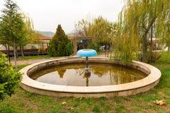 Fountain near the tree Royalty Free Stock Image