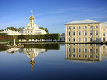 Fountain Neptune on the background of the housing Stamp Big Peterhof Palace. Peterhof. St. Petersburg. Russia. Royalty Free Stock Images