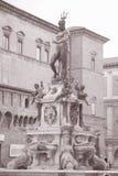 Fountain of Neptune, Bologna. Fountain of Neptune - Fontana di Nettuno by Giambologna 1567, Piazza Maggiore Square, Bologna, Italy in Black and White Sepia Tone royalty free stock photos