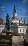 Fountain Neptune and city hall. In Poznan, Poland in background Royalty Free Stock Photos