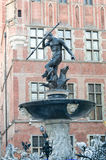 Fountain of the Neptune and city hall in Gdansk Stock Photos