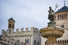 Fountain of Neptune in the city of Trento. Main square Piazza Duomo, with clock tower and the Late Baroque Fountain of Neptune. City in Trento Italy Stock Image