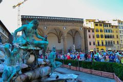 Fountain of Neptune Fontana del Nettuno in Piazza della Signor. A with a lot of people in front of it. Florence, Italy royalty free stock photo