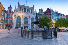 Fountain of the Neptune in old town. Of Gdansk at dawn, Poland Stock Photography