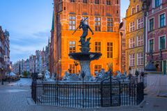 Fountain of the Neptune in old town. Of Gdansk at dawn, Poland Stock Photo