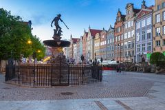 Fountain of the Neptune in old town. Of Gdansk at dawn, Poland Royalty Free Stock Photos