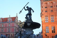 Fountain of the Neptune in old town. Of Gdansk at dawn, Poland Stock Images