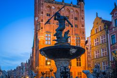 Fountain of the Neptune in old town. Of Gdansk at dawn, Poland Royalty Free Stock Photo