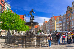 Fountain of the Neptune in old town of Gdansk. GDANSK, POLAND - MAY 11, 2015: Fountain of the Neptune in old town of Gdansk, Poland. The bronze statue of Neptune Royalty Free Stock Images