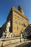 Fountain of Neptune and Palazzo della Signoria in Florence. FLORENCE,IT - SEPTEMBER,9 2016 - Fountain of Neptune and Palazzo della Signoria in Florence Royalty Free Stock Photo