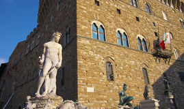 Fountain of Neptune and Palazzo della Signoria in Florence. FLORENCE,IT - SEPTEMBER,9 2016 - Fountain of Neptune and Palazzo della Signoria in Florence Royalty Free Stock Photos