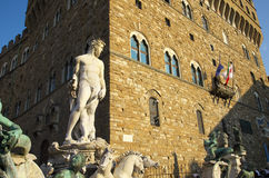 Fountain of Neptune and Palazzo della Signoria in Florence. FLORENCE,IT - SEPTEMBER,9 2016 - Fountain of Neptune and Palazzo della Signoria in Florence Royalty Free Stock Photography