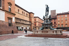 Fountain Neptune on square in Bologna city. BOLOGNA, ITALY - OCTOBER 31, 2012: Fountain Neptune on Piazza del nettuno in Bologna city. The Fountain was designed royalty free stock images